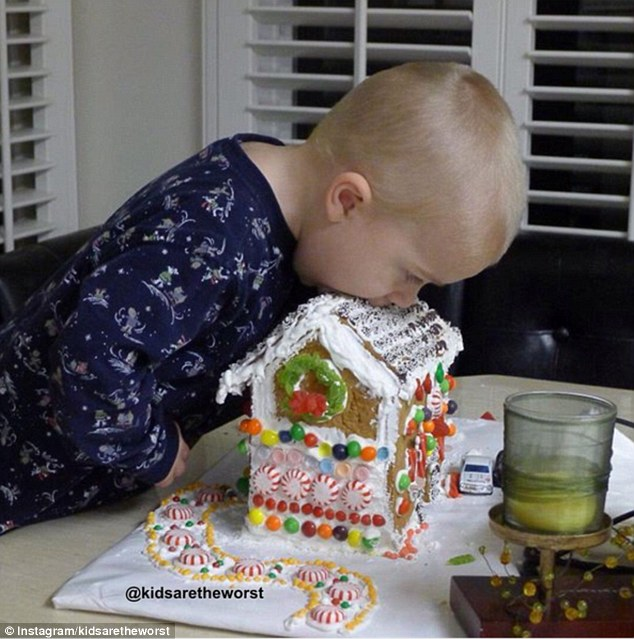 Just a bite: One young boy dove headfirst in to the gingerbread house, ruining it for everyone else