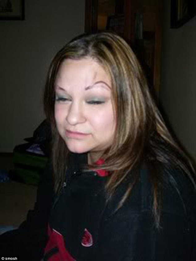 This woman's eyebrows appear to have been slightly smudged off and up her face