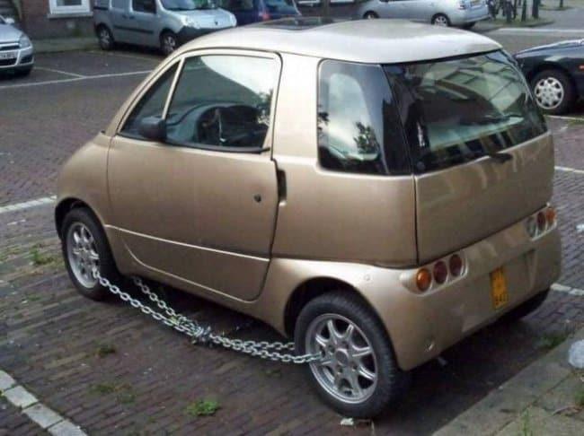 Security Fails car wheels chainedSecurity Fails car wheels chained